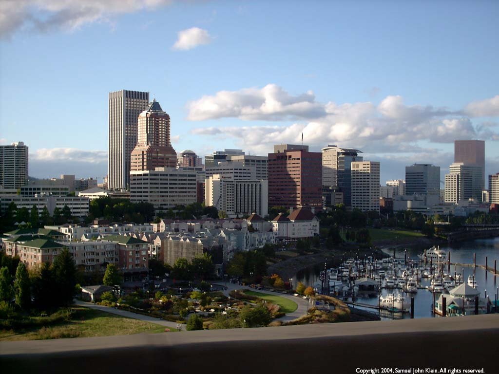 Downtown Portland as seen from the back seat of a Subaru wagon cruising along the top deck of the Marquam Bridge
